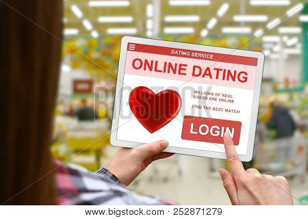 Online Dating Concept, Girl With Tablet Pc On Blurred Shop Background