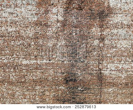 A Grungy Red Brick Wall Texture Or Background