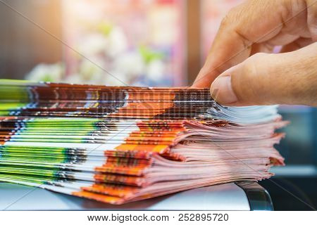 Businessman Hands Searching Stack Of Brochure Report Paper Documents For Business Desk, Business Pap
