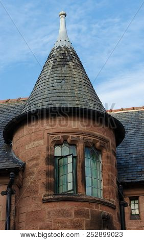 An unusual round turret style feature on a residential house in Cheshire. poster