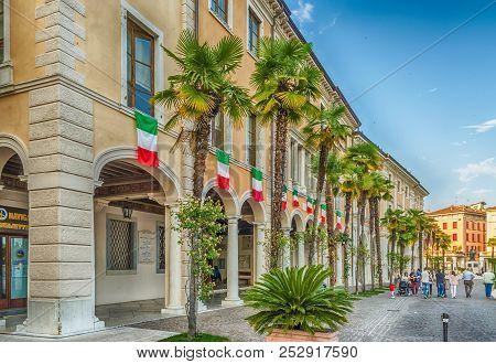 Salo, Italy - June 1: Italian Flags On The Facade Of Palazzo Della Magnifica Patria, Iconic Building