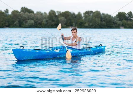 Strong Active Sportsman Taking Part In Kayaking Competition