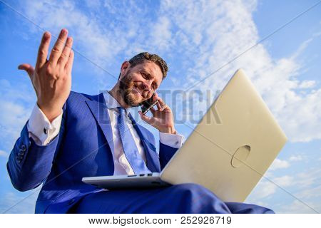 Sales Manager Responsibilities. Stay In Touch. Man Formal Suit Work With Laptop While Speak On Phone
