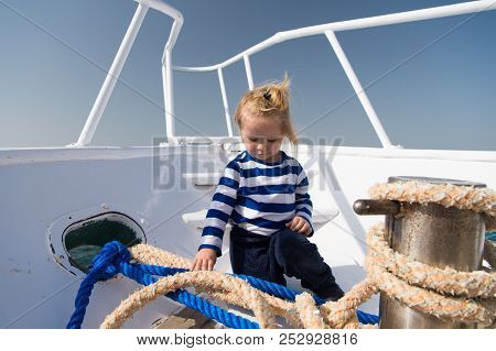 Travel In Summer Concept. Little Child Travel On Ship In Summer. Baby Boy Travel By Sea. Summer Vaca