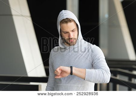 Little Break. Man Athlete Concentrated Face Checking Time Smart Watch Urban Background. Athlete With