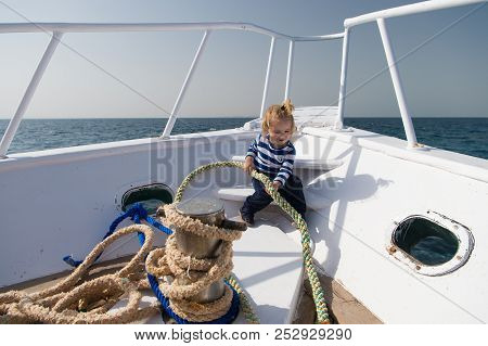 Sea Trip Concept. Small Kid Enjoy Sea Trip On Boat. Boy Sailor On Sea Trip. Sea Trip And Cruise. Let