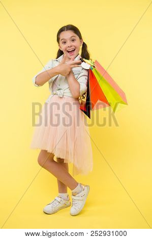 Shopping Bag At Child. Child With Shopping Bag. Purchse Insedi Of Shopping Bag In Hand Of Kid. Happy