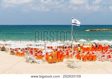 Tel Aviv, Israel - August 09, 2018: Seafront Of The Mediterranean Sea, Beach With Umbrellas And Deck