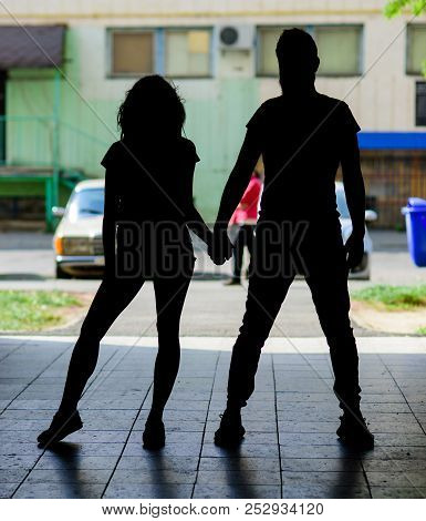 Silhouette Couple In Love Against Urban Background. Youth On Date Spend Time Together. Man And Slim