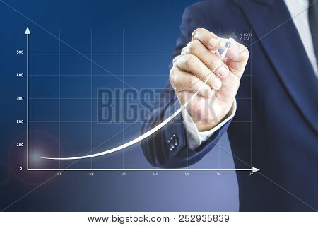 Businessman Drawing An Exponential Curve Of A Progress In Business Performance, Return On Investment