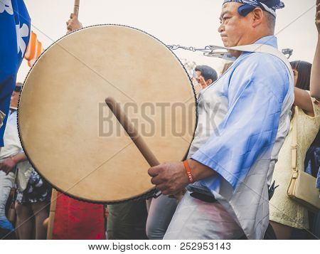 Moscow, Russia - August 09, 2018: Japanese Artist Perform At Bon Festival In Blue Kimono With Big Dr