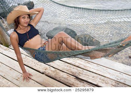 woman resting on a hammock
