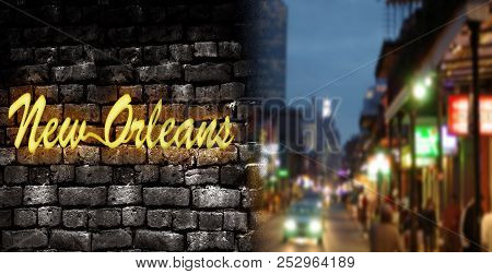 New Orleans Neon Style Sign On Brick Wall Next To Bourbon St View In The French Quarter