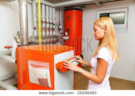 woman in the boiler room for heating
