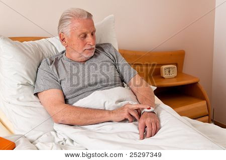 senior rufhilfe with emergency phone in bed