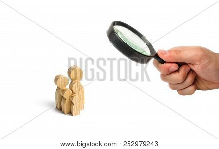 Wooden Figurines Of People In The Shape Of A Family On A White Background. The Concept Of Family Val