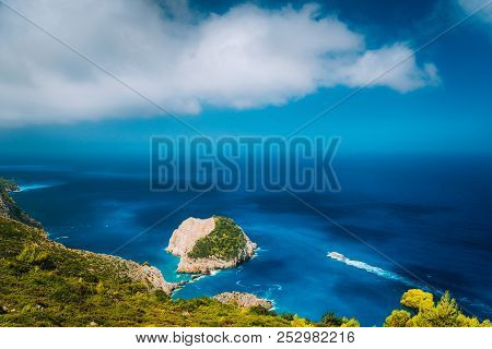 Zakynthos Fantastic Coastal View With White Cliff. White Tourist Ship Sailing Full Speed On Open Azu