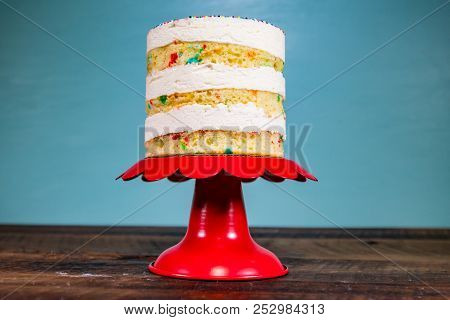 Looking Up At Small Funfetti Cake On Red Cake Stand Centered