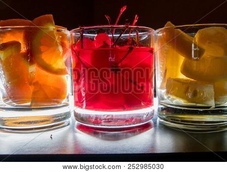 Oranges Cherries And Lemons Backlit Provide Mixers For An Open Bar