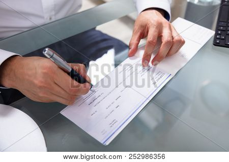 Businessman Signing Cheque