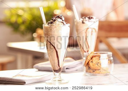 Glass With Delicious Milk Shake On Table Indoors