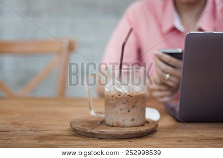 Woman Using Smart Phone In Coffee Shop, Stock Photo