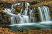 kirkjufellsfoss is just one of Icelands many beautiful waterfalls. Located on the Snaefellsnes Peninsula, just outside the toen of Grundarfjцrрur. poster