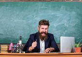 Teacher bearded man tell interesting story. Teacher interesting interlocutor as best friend. Teacher charismatic hipster sit table classroom chalkboard background. Telling educational stories poster