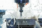 Milling metalworking process. Industrial CNC metal machining by vertical mill. Coolant and lubrication poster