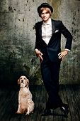 handsome  young  man in tuxedo and his dog in  grunge room poster