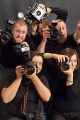 Photo of paparazzi fighting for space to take photos. poster