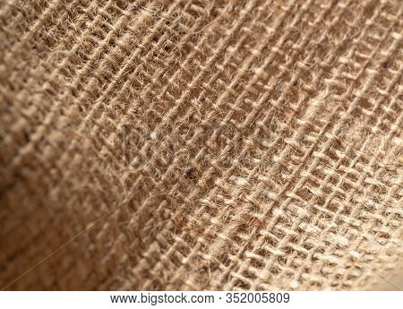 Texture Of Brown Burlap Textile, Close Up View. Brown Burlap, Abstract Background. Selective Soft Fo