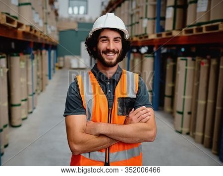 Portrait Of Cheerful Supervisor In A Warehouse For Delivering And Transporting Industrial Goods Wear