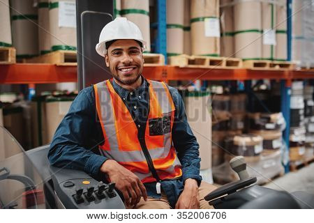 Handsome Engineer Wearing Protective Uniform And Hardhat Smiling Joyfully To The Camera Sitting In F