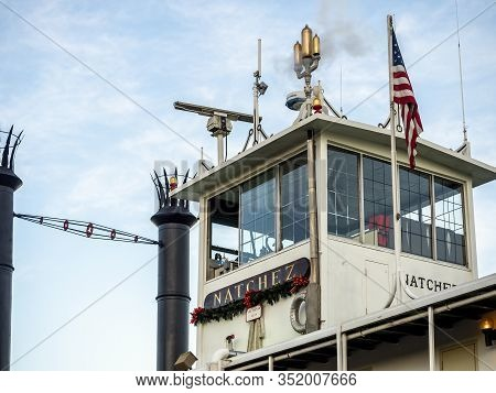 New Orleans, Usa - Dec 11, 2017: Paddle Steamboat Natchez Docked At The Mississippi River Pier. Clos