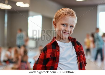 Happy Boy. Portrait Of A Cute Little Boy In Casual Clothes Looking At Camera And Smiling While Stand