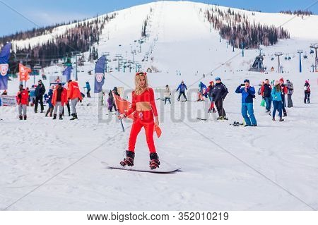 Sheregesh, Kemerovo Region, Russia - April 12, 2019: Young Happy Pretty Woman Dressed In Carnival Co