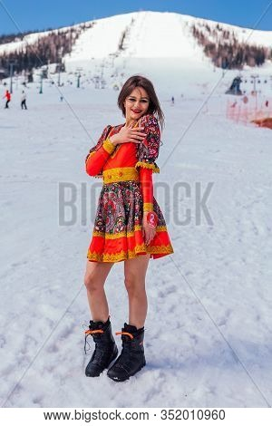 Sheregesh, Kemerovo Region, Russia - April 12, 2019: Young Happy Pretty Woman Dressed In Ethnic Dres