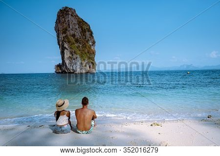 Couple On The Beach, Koh Poda Thailand, The Beautiful Landscape Of Koh Poda Or Poda Island In Krabi