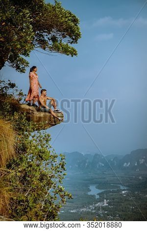 Khao Ngon Nak Nature Trail Krabi Thailand Or Dragon Crest, Couple Men And Woman Climbed To A Viewpoi