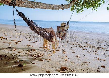 Hammock On The Beach Krabi Thailand, Woman In Swing On Ao Nang Beach Thailand Krabi