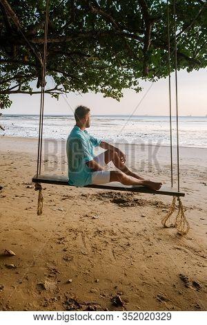 Hammock On The Beach Krabi Thailand, Guy In Swing On Ao Nang Beach Thailand Krabi