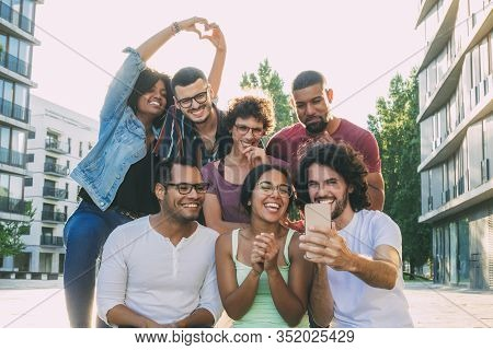 Excited Overjoyed Multiethnic People Taking Group Selfie Outside. Mix Raced Team Of Friends Posing A