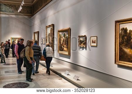 Moscow, Russia - February 11, 2020: People Look Paintings On Exhibition In Pushkin State Museum Of F