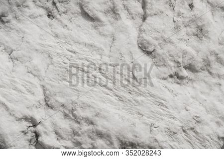 Texture Of A Stone Marble Slab. Rough White Marble. Textured Stone Background. Stone Slab Of The Rui