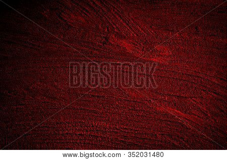Wall Grunge Red Concrete With Light Background. Dirty Wall Dark Red Concrete Texture And Splash Or A