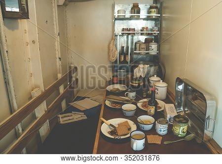 Portsmouth, England - December 4, 2019:old Vintage Kitchen, Dining Room Or Cooking Area In Hms M33 R