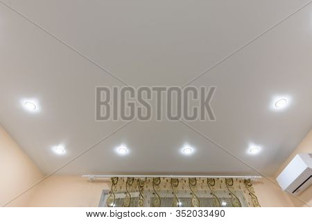 Light Bulbs Located On The Perimeter Of The Stretch Ceiling