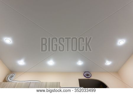 Location Around The Perimeter Of Point Lights On A White Matte Tension Ceiling