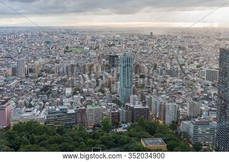Tokyo Suburb Cityscape Aerial With Endless Urban Sprawl And Green Park. Modern Asian City Developmen